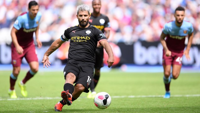 RESPONSIBILITY: Sergio Aguero scores with his second attempt from the penalty spot.
