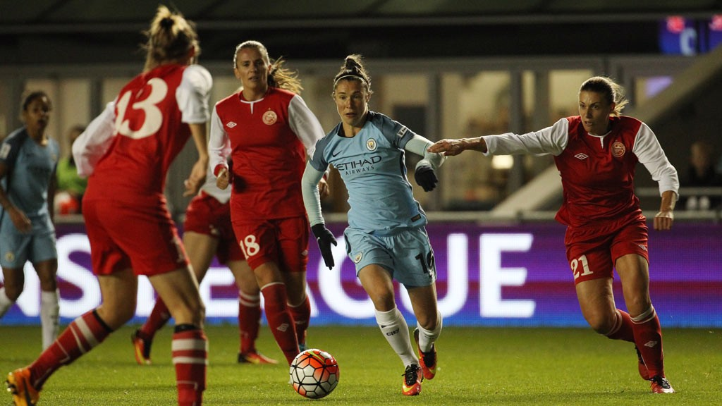 ON THE MOVE: Jane Ross picks her way through the Zvezda defence