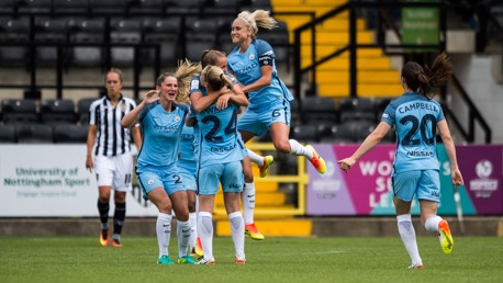 GET IN!: It's all smiles for the City players as they celebrate Georgia Stanway's goal to put them 4-0 up against Notts County Ladies at Meadow Lane.