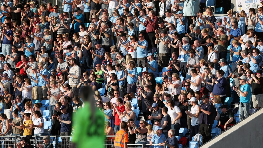 PAYING RESPECT: Supporters stood for an applause on the 22nd minute of light of recent events.