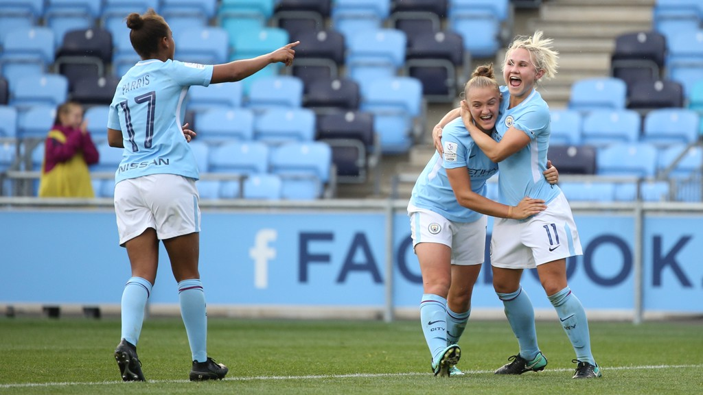 DELIGHT: Georgia Stanway and Izzy Christiansen savour the moment
