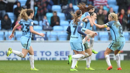 GET IN: The team celebrates Lucy Bronze's late winner!