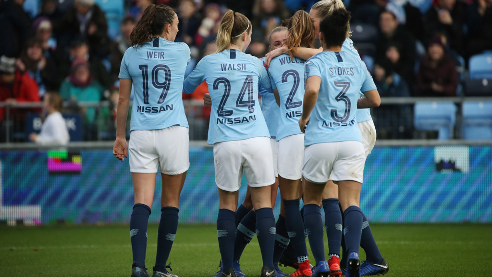 CELEBRATE: The squad after Georgia Stanway's goal.