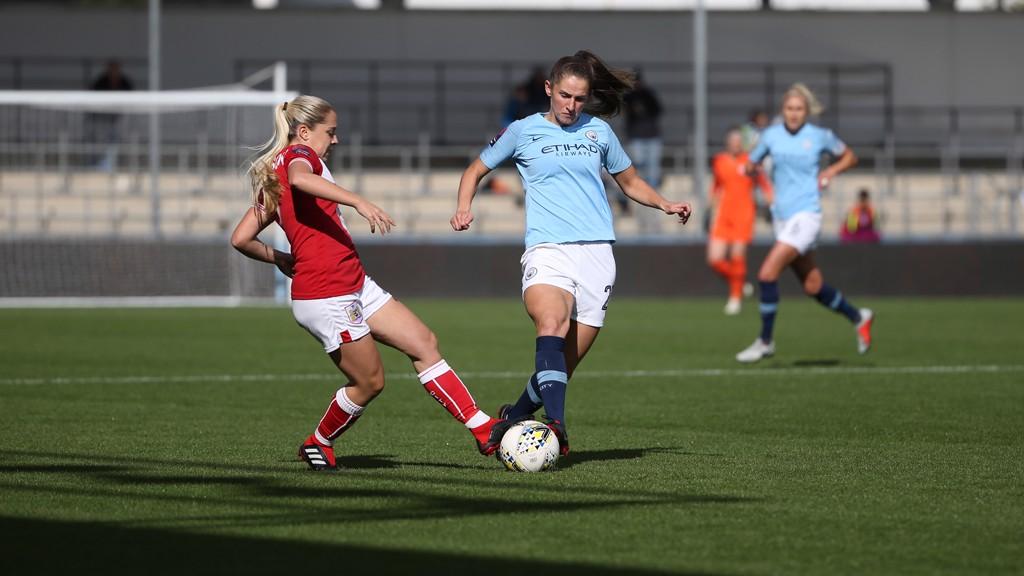 DUEL: Abbie McManus wins possession