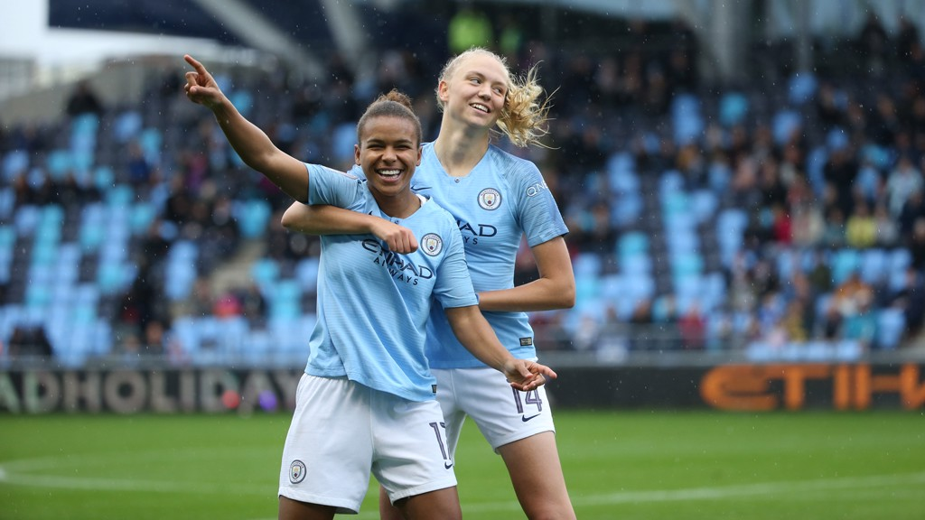 CELEBRATIONS:  Nikita Parris and Esme Morgan express their delight.