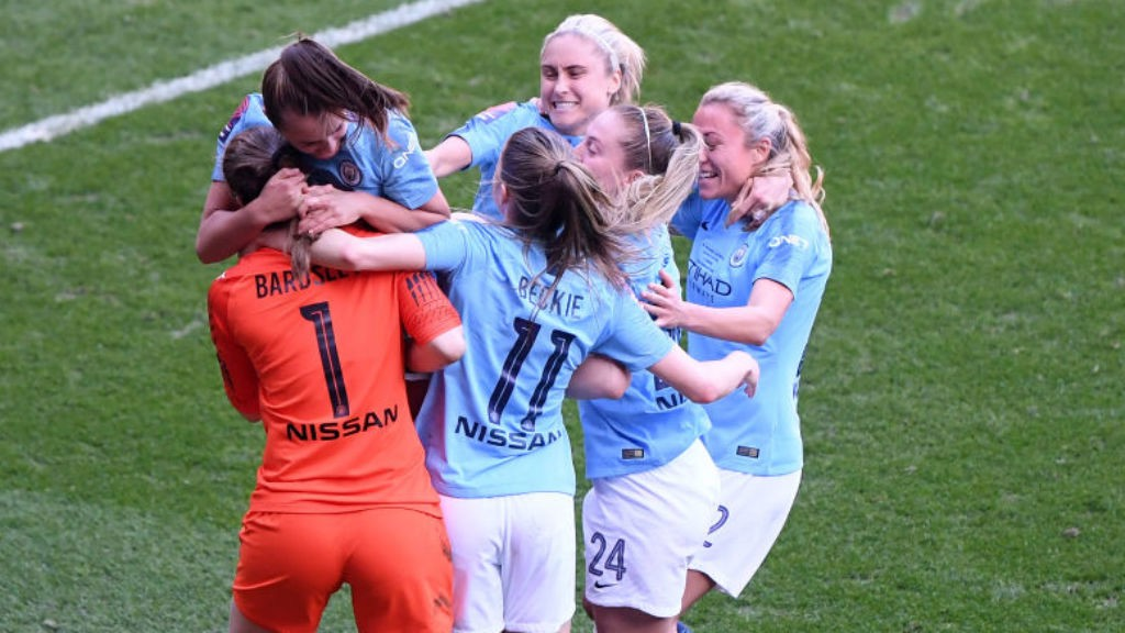 GLOVE STORY: The City players mob penalty shoot-out hero Karen Bardsley