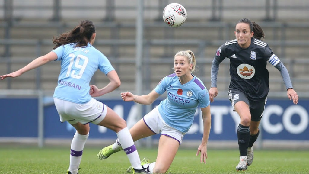 ACTION STATIONS: Caroline Weir and Gemma Bonner combine to clear the danger