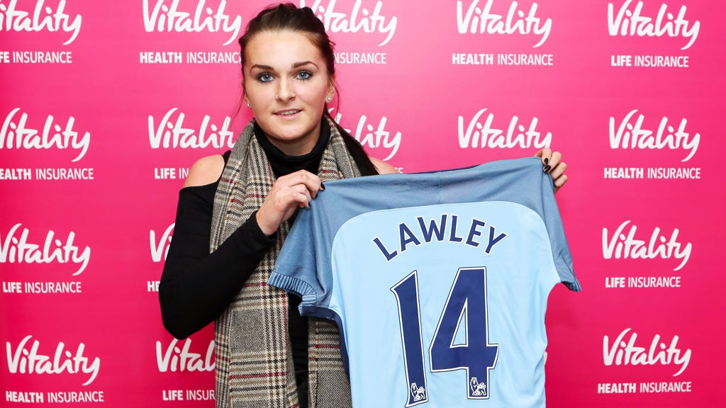 SHIRT SHOT: Melissa Lawley proudly holds up her new strip