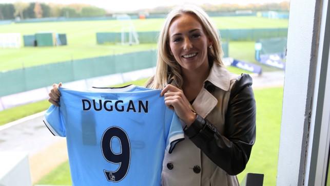 NEW BLUE: Toni Duggan poses for the famous shirt shot at Carrington