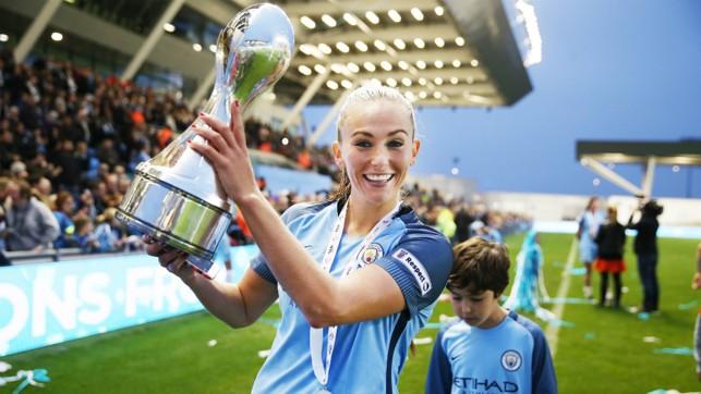 DELIGHT: Showing off the Super League title
