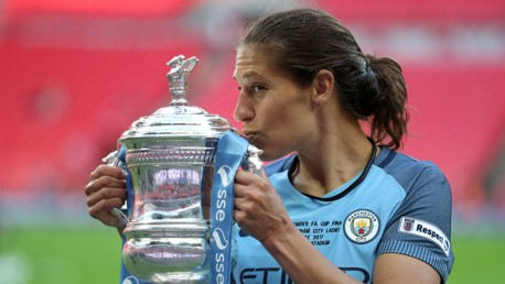 SEALED WITH A KISS: Carli Lloyd poses for a snap with the FA Cup