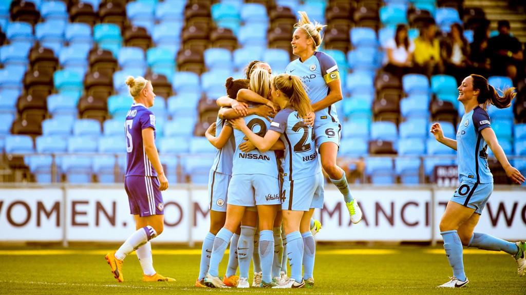 DUGGAN DELIGHT: The team congratulate Toni Duggan on her goal against Chelsea