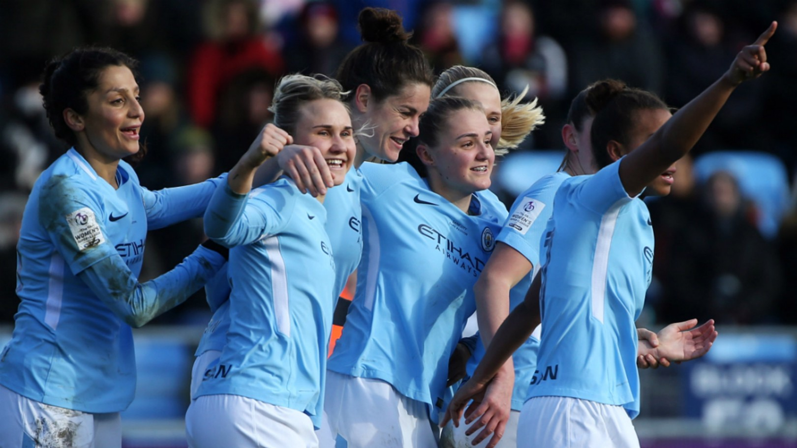 DELIGHT: Smiles all round as City celebrate