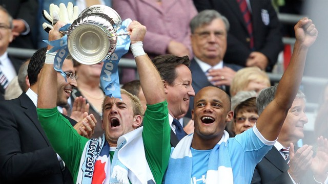 TROPHIES: Hart lifts the FA Cup after the 2011 success