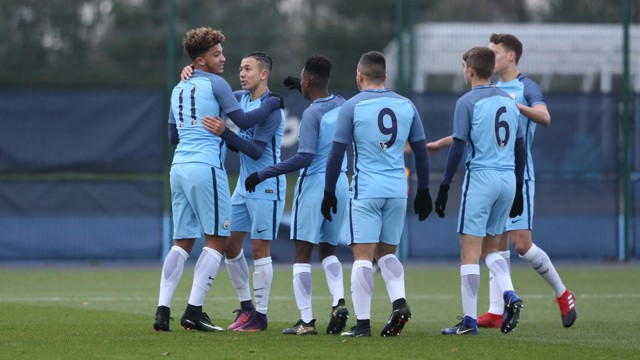 TOGETHER: City's team celebrate after an excellent opening goal against Stoke