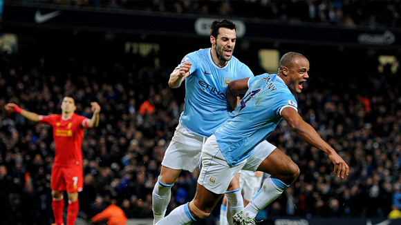UP UP AND AWAY: Kompany rises to the top to score against Liverpool in December 2013