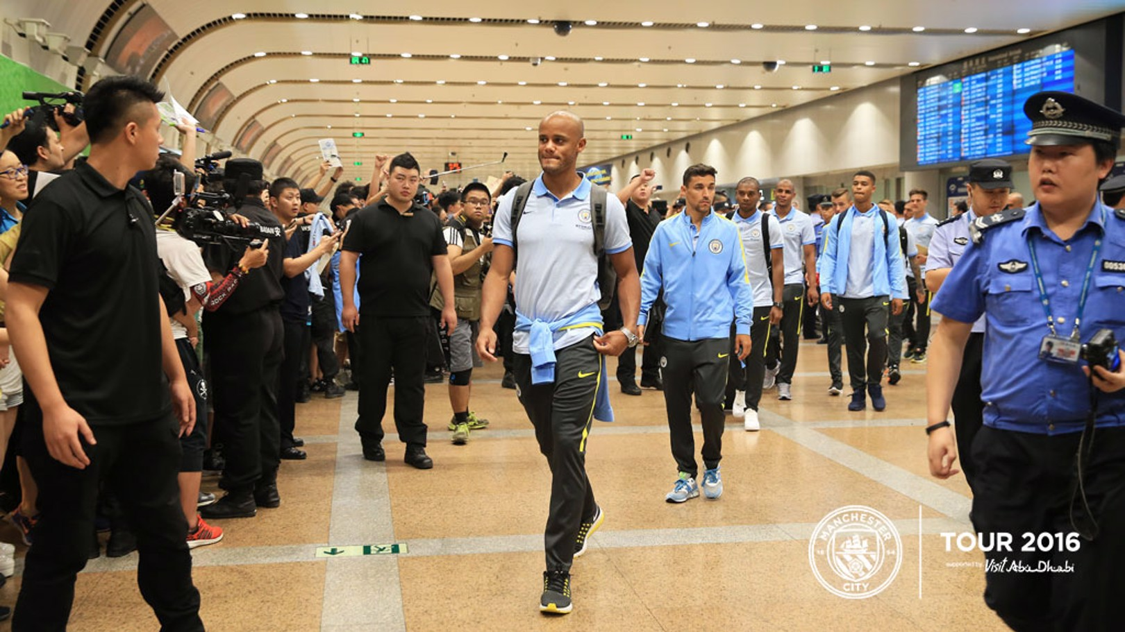TOUCHDOWN: Vincent Kompany leads the way at Beijing International Airport.