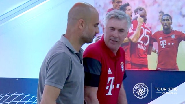 FRIENDS REUNITED: Pep and Carlo Ancelotti catch up at the Allianz