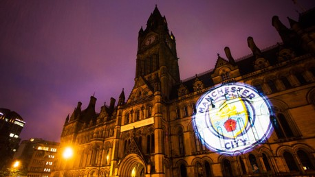 IT BEGINS: The new Badge projected onto Manchester Town Hall on Thursday night