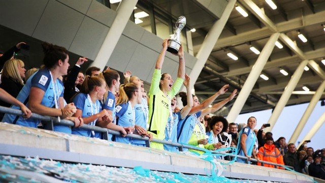 CELEBRATE: Bardsley holds the FAWSL trophy aloft