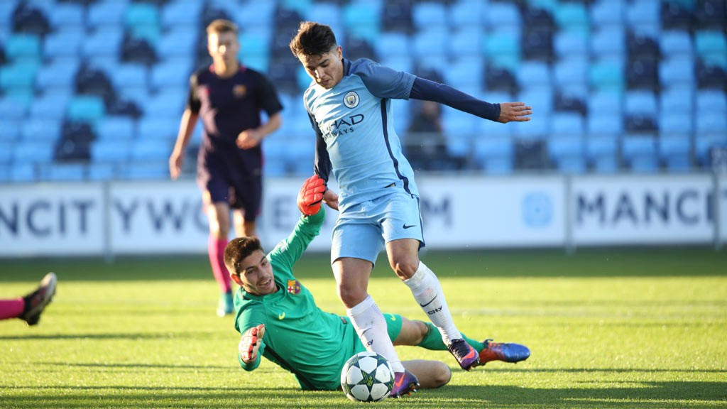 UNLUCKY: Brahim works his way around Barca keeper Puig before rolling the ball wide