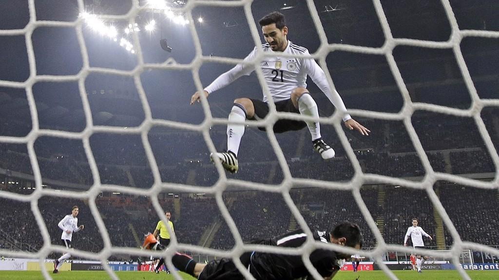 CLOSE: Gundogan leaps over Buffon