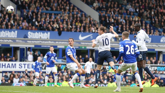 FLYING HIGH: Edin Dzeko jumps up up and away for the goal