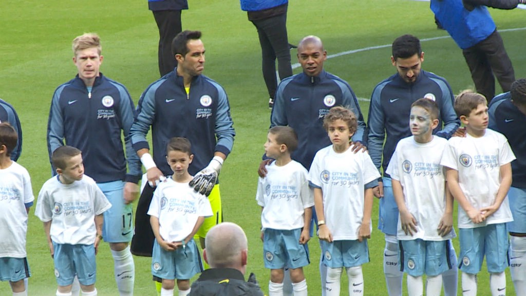 LINING UP: Fernandinho and Vitor stand in the line ahead of kick-off