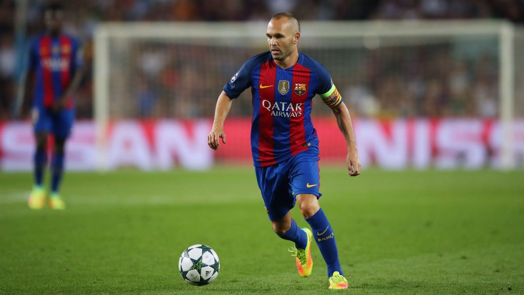 THE ARTIST: Iniesta in his familiar pose while in possession of the ball