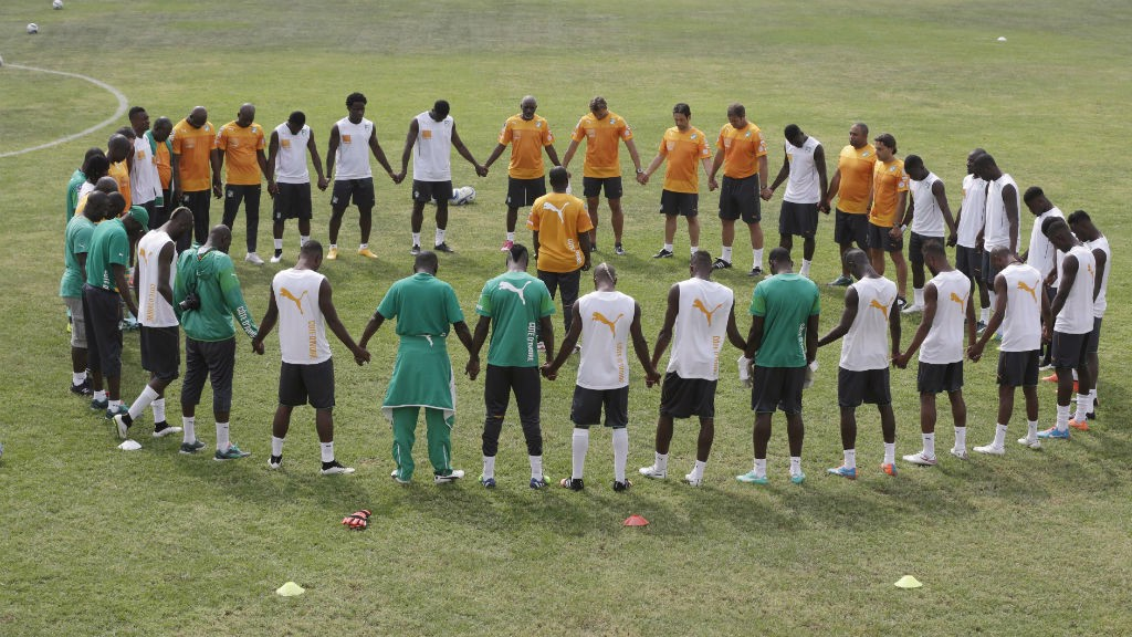 TOGETHER: Ivory Coast's squad of stars join hands as part of their preparations for the tournament