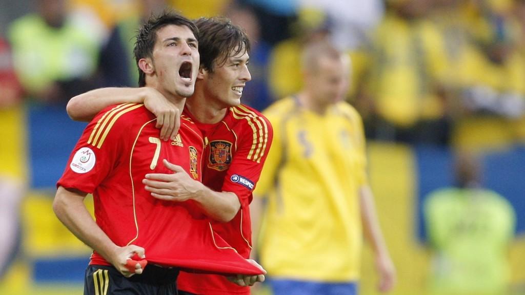 DOUBLE DAVID: Former Valencia teammates Silva and Villa celebrate
