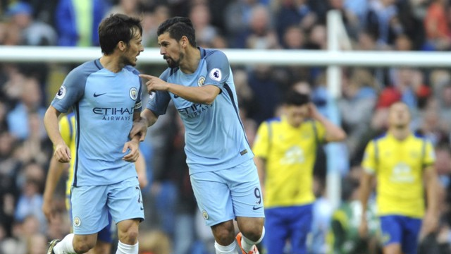 BACK IN TO IT: Silva and Nolito react to the latter's goal during Silva's excellent showing against Everton