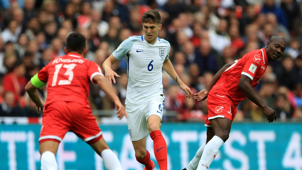 BALL CARRIER: Stones is delighted with how new boss Gareth Southgate has settled with England