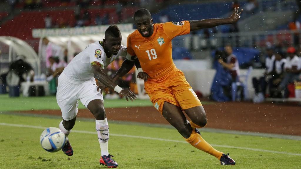 WORKING HARD: Yaya tussles with Ghana's Afriyie Acquah in a bid to get ahead in the final