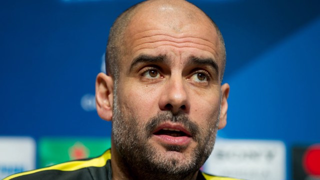 PEP: City's manager listens intently as he awaits questions before the Monaco clash