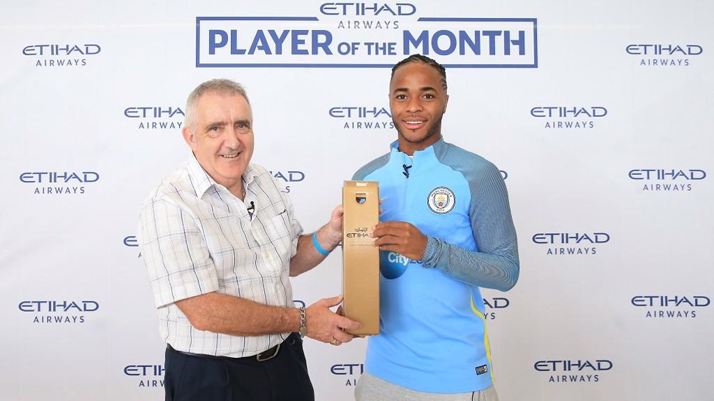 WINNER: Raheem receives his award from a City fan