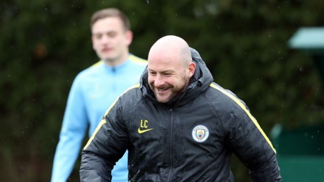 SMILES: Lee Carsley takes training with Luke Bolton listening intently from behind