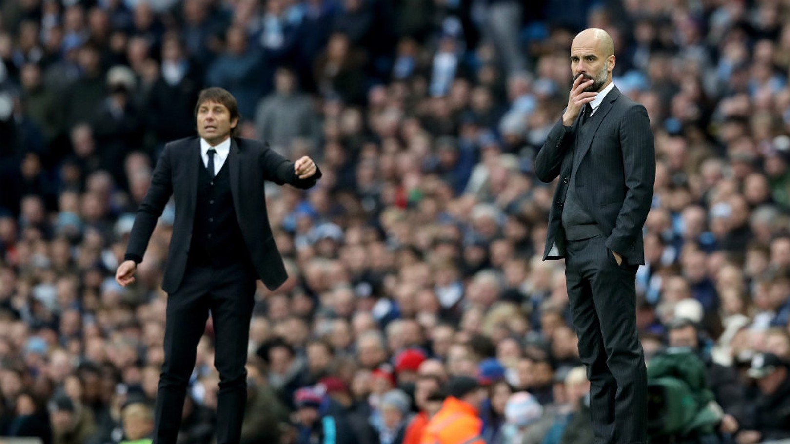 TOUCHLINE: Pep Guardiola and Antonio Conte watch the action.