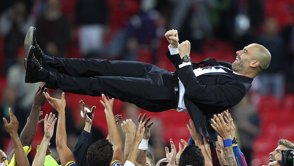PEP: Barca players celebrate their 2011 win with the boss