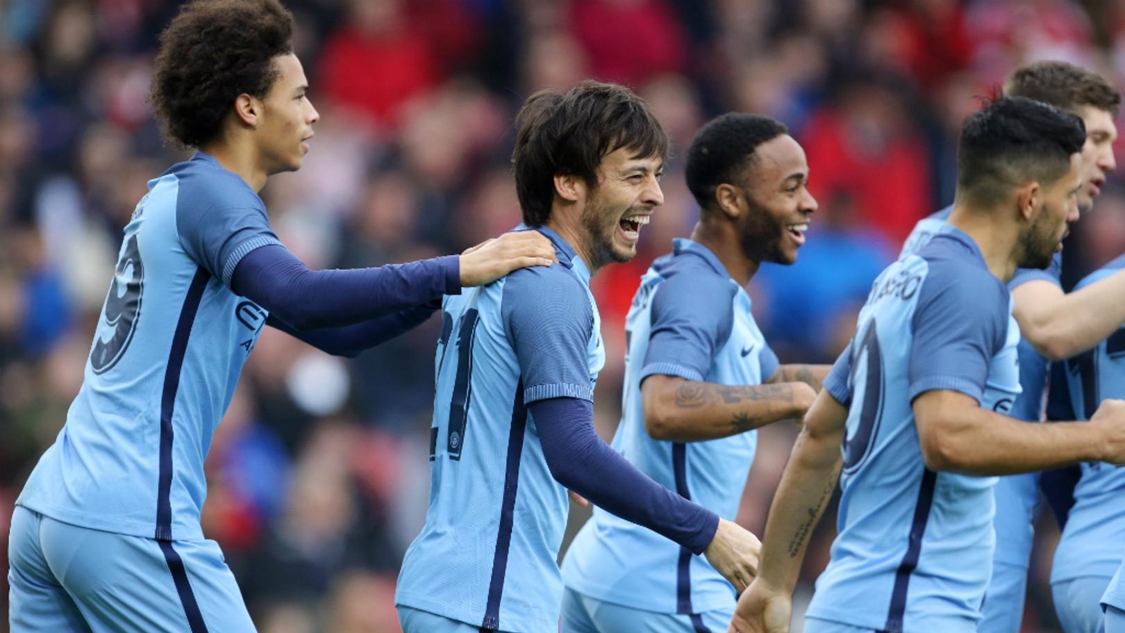 MAGIC: The City players rush over to congratulate David Silva
