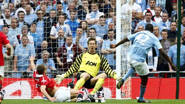 CLINICAL: Yaya Toure beats Manchester United goalkeeper Edwin van der Sar to put City ahead in the FA Cup semi-final.