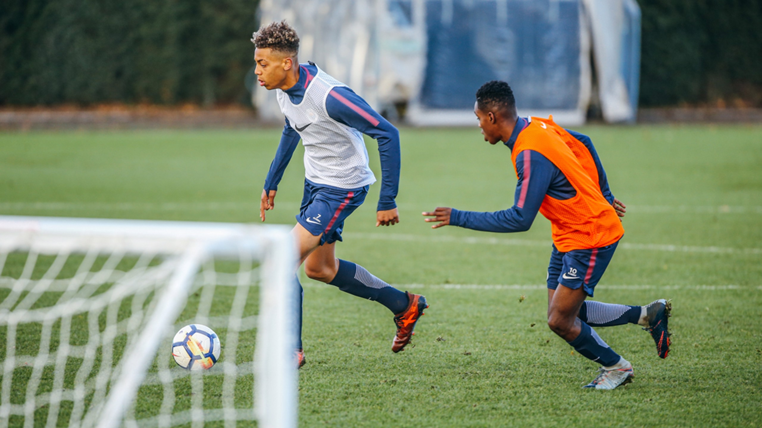 DRILL: Jeremie Frimpong pursues Felix Nmecha in training.