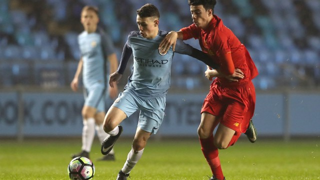 PHIL FODEN: City's midfielder drives forward during the victory over Liverpool in the FA Youth Cup
