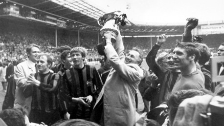 MIGHTY MERCER:  Surrounded by his triumphant team, shows off the FA Cup to the fans during the lap of honour