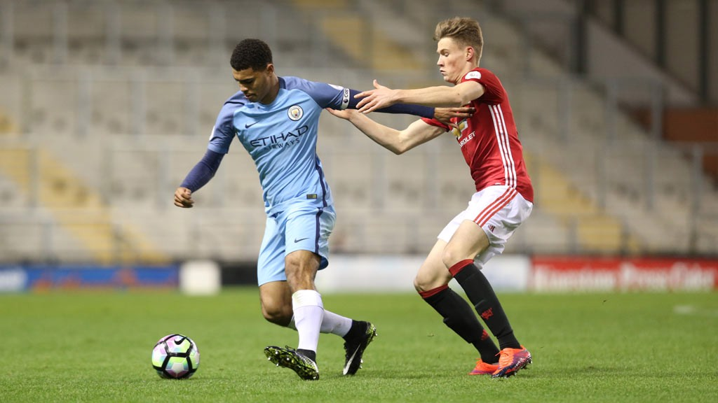 HUMPHREYS: City's centre-back holds off a challenge during the first half of the Premier League 2 derby