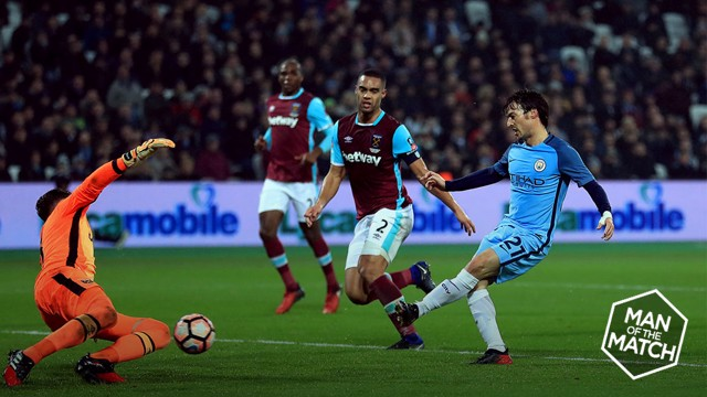 SILVA SERVICE: David Silva takes his time before coolly slotting past Adrian for City's third against West Ham