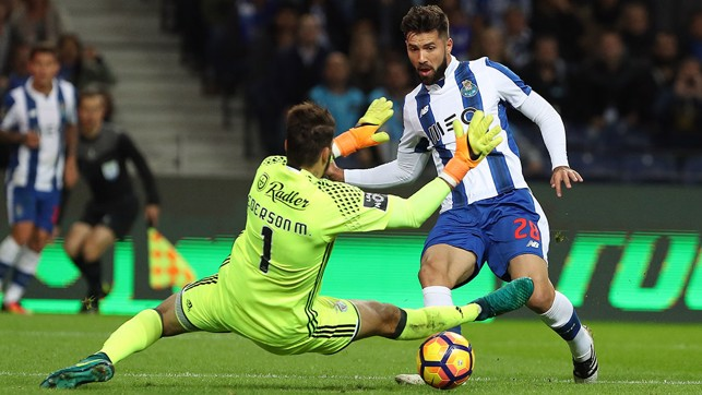 SMOTHERING THE DANGER: Ederson is quick off his line to claim the ball at the feet of Porto's Felipe.
