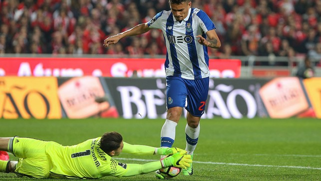 OUT QUICKLY: Ederson is brave at the feet of Tiquinho in the 1-1 draw with Porto on 1 April.