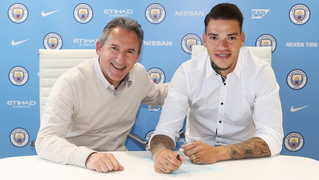 SIGNING: Ederson signs on the dotted line with Txiki Begiristain.