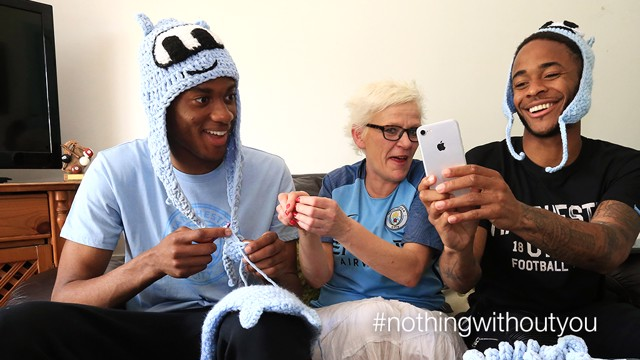 SELFIE: Raheem Sterling and Tosin Adarabioyo pose for a picture with City fan, Julie Dolan.